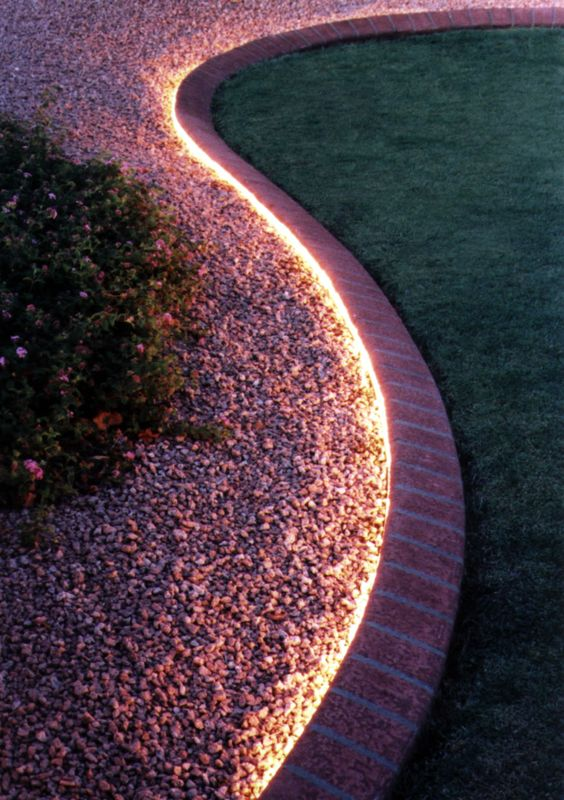 Garden Strip Lights Around A Rockery Gravel Garden